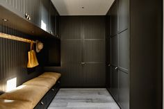 In this modern mudroom, large overstuffed light brown leather pillows cushion the built-in bench with storage, while black cabinets with leather drawer . Built In Bench, Black Cabinets, Upper Cabinets, Interior Exterior, Brown Interior, Cool Rooms, Black House, Built Ins, Modern Farmhouse