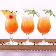 Pineapple Rum Punch  10 Ingredients  3-1/2 cups unsweetened pineapple juice  1-1/2 cups orange juice  1 cup coconut water  1 cup coconut rum  1 cup orange peach mango juice  1 cup dark rum  1/4 cup Key lime juice  3 tablespoons Campari liqueur or grenadine syrup  Directions  In a pitcher, combine all ingredients. Serve over ice. Yield: 12 servings.