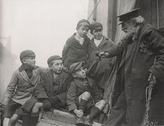 photograph of an old sailor (pipe in hand) sharing enthralling tales of adventures past with his eager young crowd.