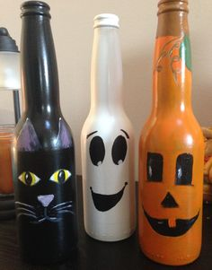 Halloween Corona bottles. Sprayed them with black radiator (bc that's what I had) first to help hide the label. Then sprayed with appropriate colors and hand painted the faces.