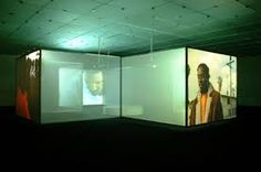 Doug Aitken-  Electric Earth Doug Aitken's Electric Earth is a multi-room, multi-screen video installation that immerses the viewer in a loosely structured narrative about a young man in a big city.