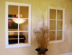 Faux windows made from mirrors to make the room seem larger.