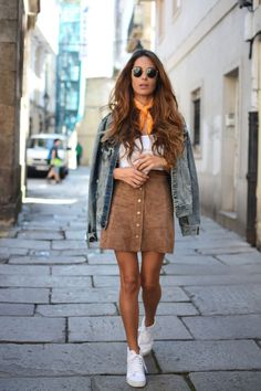 Red suede skirt, white v-neck, jean jacket, white tennis