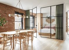 A SoHo loft apartment with exposed brick walls and a neutral color palette with subtle color touches Soho Apartment, Apartment Renovation, Soho Loft, Manhattan Loft, Warm Industrial, Industrial Kitchens, Industrial Apartment, Industrial Lamps, Industrial Furniture
