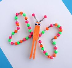 We bet the last time you looked at pipe cleaners that you did not think they could grow into a beautiful butterfly craft. But, with this Neon Beaded Butterflies craft, they can! Make this pretty little beaded butterfly craft for spring. Animal Crafts For Kids, Spring Crafts For Kids, Summer Crafts, Art For Kids, Kids Crafts, Preschool Crafts, Shoebox Crafts, Baby Crafts, Summer Fun