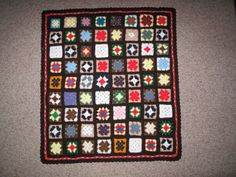 The daughter of a deceased church member brought these granny squares to me at church.  Her mother had made them and she asked if we could use them.  I put them together into a very colorful lap afghan.