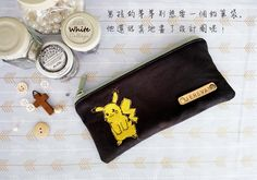 A custom-made pencil case with a light olive YKK zipper. The Pikachu is sewn on a yellow felt. Handmade by Little White Cottage.