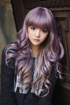 Long wavy hairstyle with terrific bangs and purple colouring
