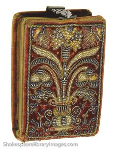 Photograph of a precious 16th century embroidered prayer book with embroidered decorative binding in the collection of the Folger Shakespeare Library. The rare book volume includes bible Psalms and the cover is embroidered with silver thread, gold thread, and tiny pearls. Photograph by Nathan Benn taken with kind permission of the Folger Shakespeare Library in 1986.  From http://www.shakespearelibraryimages.com/stock_photography_images/folger-shakespeare-library-2/?pid=125