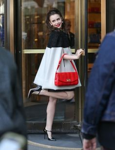 Lily Collins kicks up her heels for a swinging '60s photoshoot in NYC