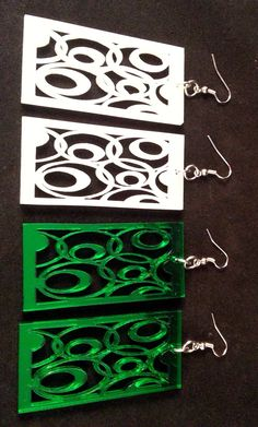 Oval Abstract Dangle Earrings White or Green Mirror Acrylic Lightweight by trianglecustomcreati on Etsy https://www.etsy.com/listing/181038346/oval-abstract-dangle-earrings-white-or