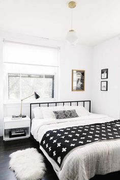 Small monochrome bedroom with a black metal bed frame simple bedding a pendant b. Small monochrome bedroom with a black metal bed frame simple bedding a pendant bed bedding Bedroom Home Decor Bedroom, Scandinavian Design Bedroom, Bedroom Interior, Bedroom Design, Black Bed Frame, Bohemian Bedroom Decor, Simple Bed, Cozy Master Bedroom, Black Metal Bed Frame