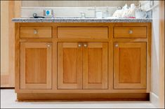 Birch inset vanity with false front underneath sink by A. Fillinger Inc. in Milwaukee