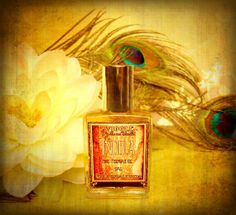 .Wiggle Perfume - Indira     Indira is a seductive blend of creamy vanilla, three top shelf Indian musks, fig, lotus, and real cardamom essential oil. It's sweet, creamy, and spicy hot, but balanced with enough intoxicating floral to stay out of the dessert genre.