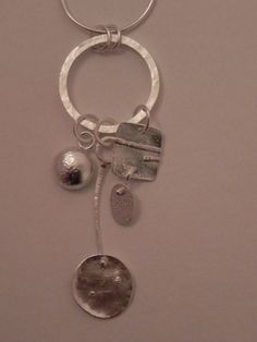 Treasure necklace. Handcrafted in sterling silver by Quench & Pickle. Reticulation and hammered textures.