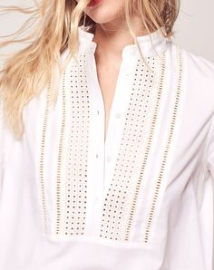 The Fit+ Relaxed fit+ Fits true to size+ Model pictured is a size 8 wearing a size 8 Style NotesWith its intricate lace detailing and pleat detailed collar, this shirt is all about every