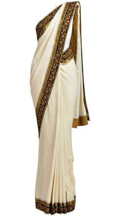 SABYASACHI  Ivory khadi sari with zardosi border.