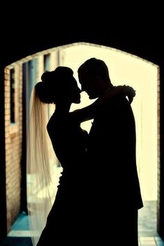 silhouette. Wedding poses. Bride and groom. Romantic
