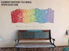 Whole school mural project made from individual clay tiles, each imprinted with a shoe sole.
