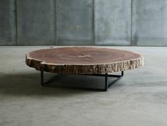 "USONA - Coffee table with metal base and top in Bubinga wood.      Dimensions:  47.25"" diam. x 12""H  Material:   Bubinga wood, metal.  Finish:"