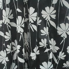 Set on a black background this John Kaldor dress fabric incorporates a white floral design and would look lovely made into a skirt or a blouse.