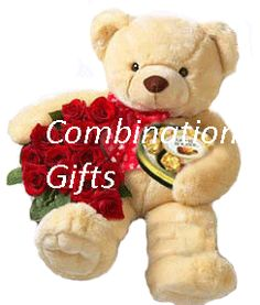 An awesome combination of flowers & teddy...
