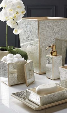 The intricate design of our Miraflores Bath Accessories is painted by hand on mirrored glass panels, and mounted on wood. An intricate finishing process creates the dazzling sparkle effect.
