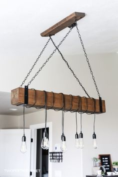 Do you want a beam light fixture in your home? Use this tutorial on how to create a DIY farmhouse wood beam chandelier for you home. Diy Pendant Light, Wood Chandelier, Chandeliers, Diy Fireplace, Wood Beams, Pendant Light Fixtures, Industrial Lighting, Led, Modern