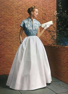 Elegant. Balmain 1953 L'officiel de la mode Two- tone evening gown, blue and white, full skirt. color photo print ad model magazine