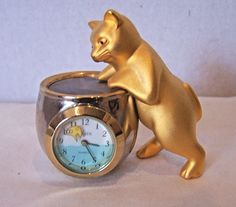 Elgin cat at fish bowl brass quartz miniature clock fish second hand