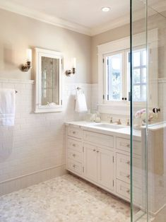 white bathroom cabinets with marble countertops and subway tile backsplash white single vanity installed over bathroom window framed with decorative