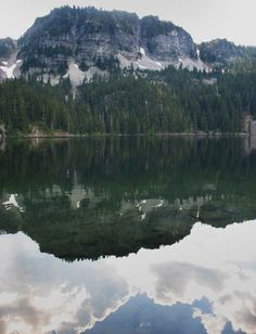 A high rock face is reflected in Fisher Lake, near the Tonga Ridge trail. For more on this and other Western Washington hikes, go to http://www.heraldnet.com/section/hikingguide. (Photo by Jessi Loerch, The Herald)