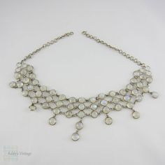 (http://www.addysvintage.co.uk/vintage-synthetic-moonstone-silver-necklace-open-backed-bezel-set-choker-necklace-in-adjustable-length/)