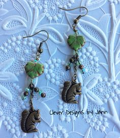 Squirrel Earrings .. Cute squirrel charms dangle under glass Maple Leafs ..  Also I used light green rondells and brass beads .. FOR SALE $19.99 https://www.etsy.com/shop/CleverDesignsbyJann