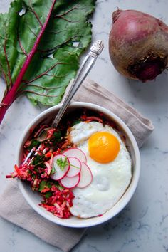 Bright Beet Quinoa Salad with Lemon and Ginger, topped with a fresh fried egg and radishes (ad) | uprootfromoregon.com
