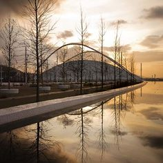 Main entrance of the Olympic Stadium Complex at sunset