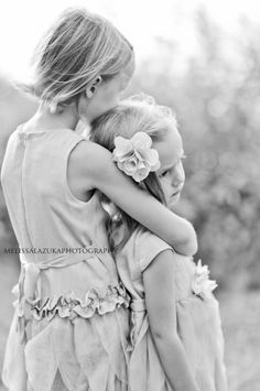 love love love this image and pose- for two sisters, a mother and girl, or even an engagement picture