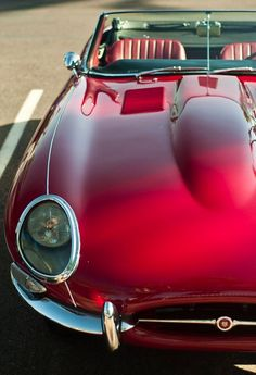 red - this is about a 1962 Jaguar XKE convertible. My dad had this car in white with a black roof. I learned to drive a stick in this car. Sexy as hell.