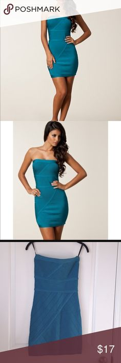 Bebe bandage dress. Classic Kim K curvy style Blue teal bandage dress. Mini dress. Zip up in back. Dress has been worn and shows signs of slight wear. I.e. Light frayed thread at 2 seams. The price reflects the condition of the dress. bebe Dresses Mini