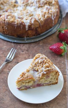 A super moist coffee cake with strawberries, streusel topping, and lemon glaze. Yeast is the secret to the incredible fluffy texture (no kneading required!)