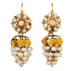 From Napoleonic Paris, probably around 1800, come these lovely ear-bobs designed to take a lady from day to night, and on the fly no less. The heavy grape clusters at the bottom, formed of gold filigree leaves and freshwater pearls, detach from the more demure roundels of gold and pearls at the top.