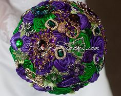 Potential wedding colors: purples emerald green and gold