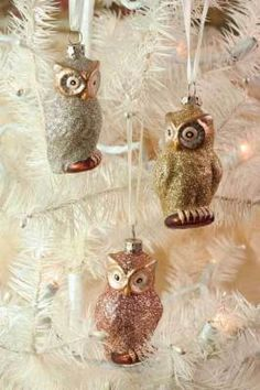Gilda, Gertie, and Gussie Owl Ornaments. A vintage-inspired mold produces a threesome of hoot owls in luscious metallic hues of sterling, rose and 14 karat. Glittered glass.