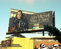 Literally awesome Joni Mitchell billboard for Miles of Aisles.
