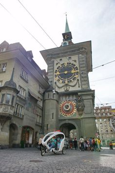 """discover Berne, the capital of Switzerland, with the help of a """"Rikscha""""-Tour.....by the way, the tower in the background is the famous """"Zytglogge"""""""