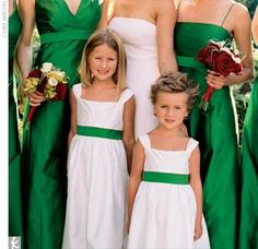 The emerald green sashes of the flower girls picked up the shade of the bridesmaid dresses.