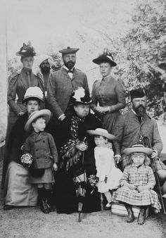"Standing: Princess Alix of Hesse, Queen Victoria's Indian servant ""Munschi,"" Prince Henry of Battenburg ""Liko"" Beatrice's husband, Princess Victoria of Battenburg  Seated: Princess Beatrice, one of Beatrice's sons, Queen Victoria, Beatrice's other son and daughter, and Alix's father, Grand Duke Louis of Hesse.   c. 1890.  This picture absolutely kills me because of the sour expression on Queen Victoria's face."