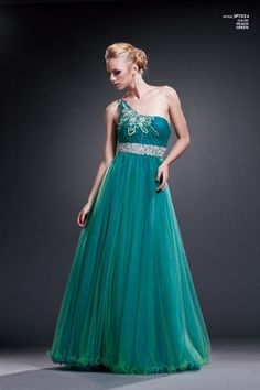 This long, puffy dress has layered tulle over the bust, shoulder, and skirt. It has delicate beading across the bust and waist. #BallGownDress