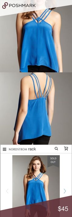 """BCBG Strappy Silk Blue Tank Sold out style. NWT. Making room in my closet. V-neck with strappy cutouts - Spaghetti straps - Sharkbite hem - Approx. 25"""" shortest length, 29"""" longest length - Imported Fiber Content 100% silk Care Dry clean Additional Info Fit: this style fits true to size.   Model's stats for sizing: - Height: 5'11"""" - Bust: 32"""" - Waist: 24"""" - Hips: 35"""" Model is wearing size S. ASOS Tops Tank Tops"""