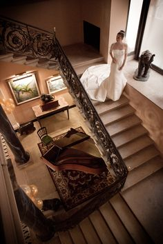 Bride on the staircase at The Port Lympne Mansion